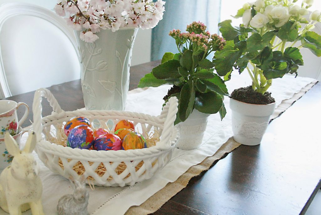 easter egg decorating table with spring flowers, easter decorating