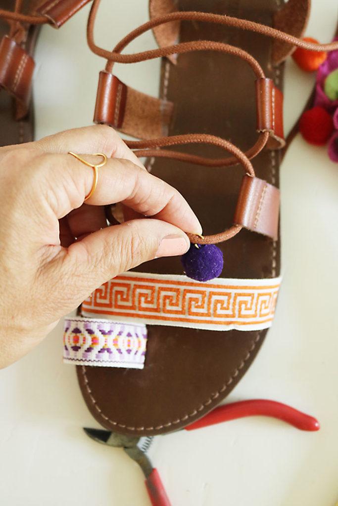 DIY-pom-pom-sandals-putting-on-pom