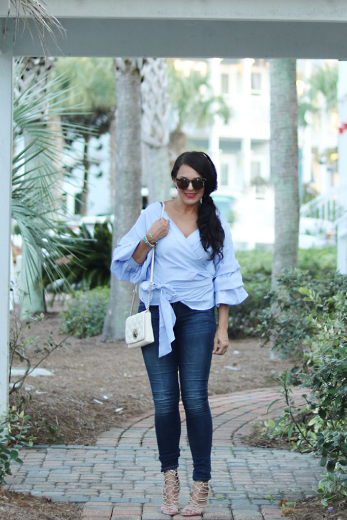 ruffled-shirt-with-jeans-shop-bop, ruffled-sleeve-wrap-shirt-and-jeans, laced heels, shop bop, classy blue on blue outfit styling fall fashion trend 2016, beach style