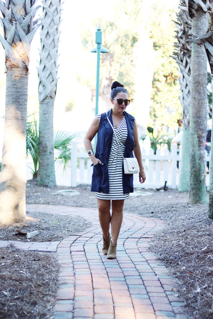 transitional-clothing-for-fall-walking, transitional-pieces-for-fall, transitioning summer to fall outfit, transitional wardrobe, fall wardrobe, black and white striped dress, summer dress, cardigan, dress with booties
