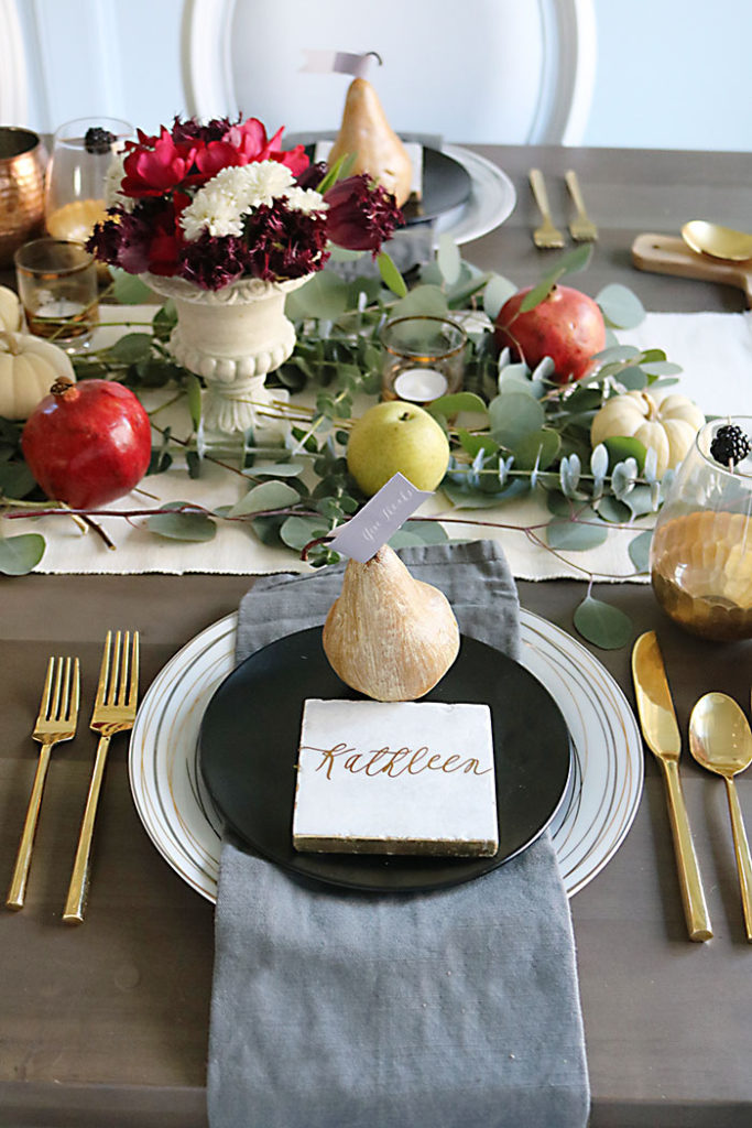 farm-to-table-fruit-on-thanksgiving-table, farm-to-table-thanksgiving-table-decor, farm-to-table-thanksgiving-flower-and-fruit, thanksgiving centerpiece, tablescape, organic raw, fresh fruit, autumn colors, pearls, metallic pears, thanksgiving table decor, name placement,