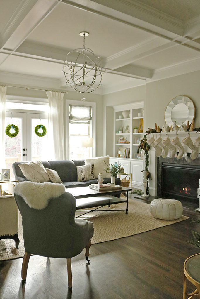 christmas-living-room-with-wreaths, christmas-decorations-living-room-shot, fireplace mantle christmas decorations, magnolia garland, winter white christmas, living room christmas decorations