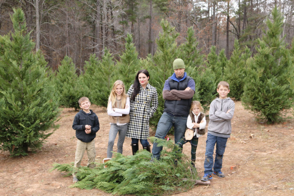 cutting-down-the-christmas-tree-family-pictuyre