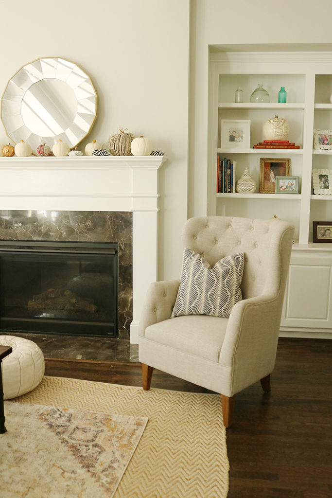 updating living space for fall, navy and white pillows, fall farmhouse living room, update living room on a budget, update living room interiors, update living cozy rustic farmhouse, fall home tour, layer rugs,