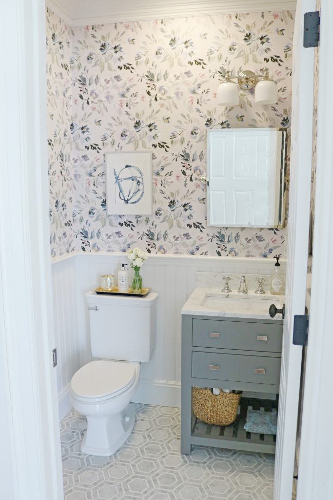 I am so excited to reveal our Powder Bathroom Makeover!  The before and after transformation is amazing!  We used Thassos mosaic Marble tile, Caitlin Wilson Design Wallpaper, Wayfair bathroom vanity, Pottery Barn bathroom fixtures. The Powder bathroom makeover has a modern, farmhouse but elegant style with navy and gray accents.    Darling Darleen #darlingdarleen #powderbathroom #mosaictile