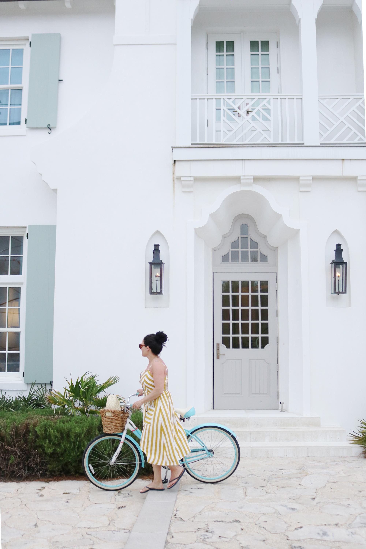 Biking around Alys Beach in my yellow striped button up dress, what beach vacation maxi dress to pack || Darling Darleen