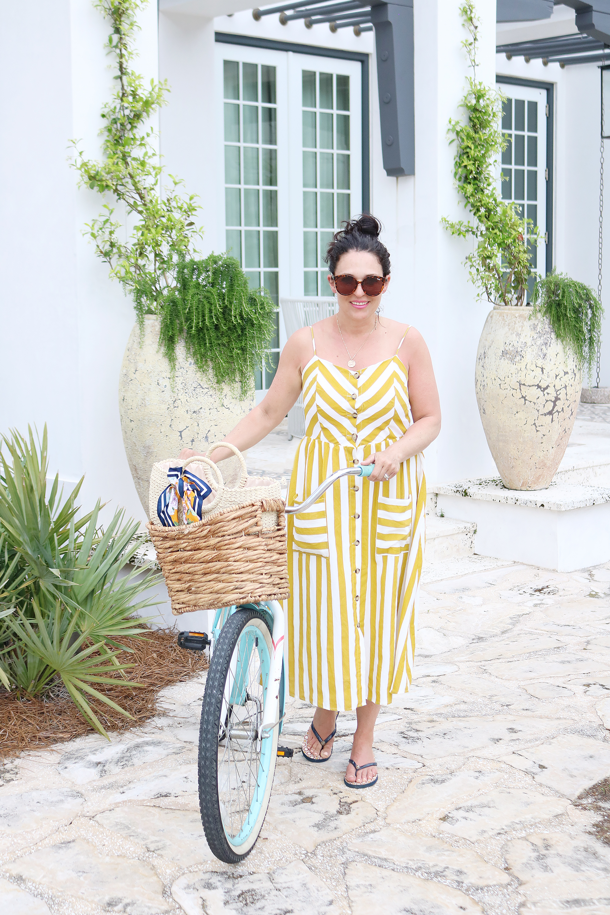 Biking around Alys Beach in my yellow striped button up dress, what beach vacation maxi dress to pack when at the beach, beach bike with basket || Darling Darleen