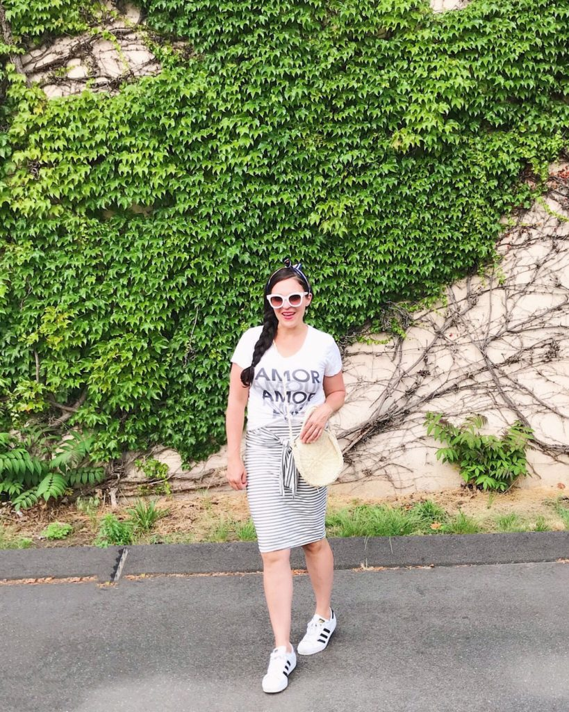 Graphic tee summer trend with skirt, summer outfit idea with Puma sneaker shoes, Saturday day casual outfit day