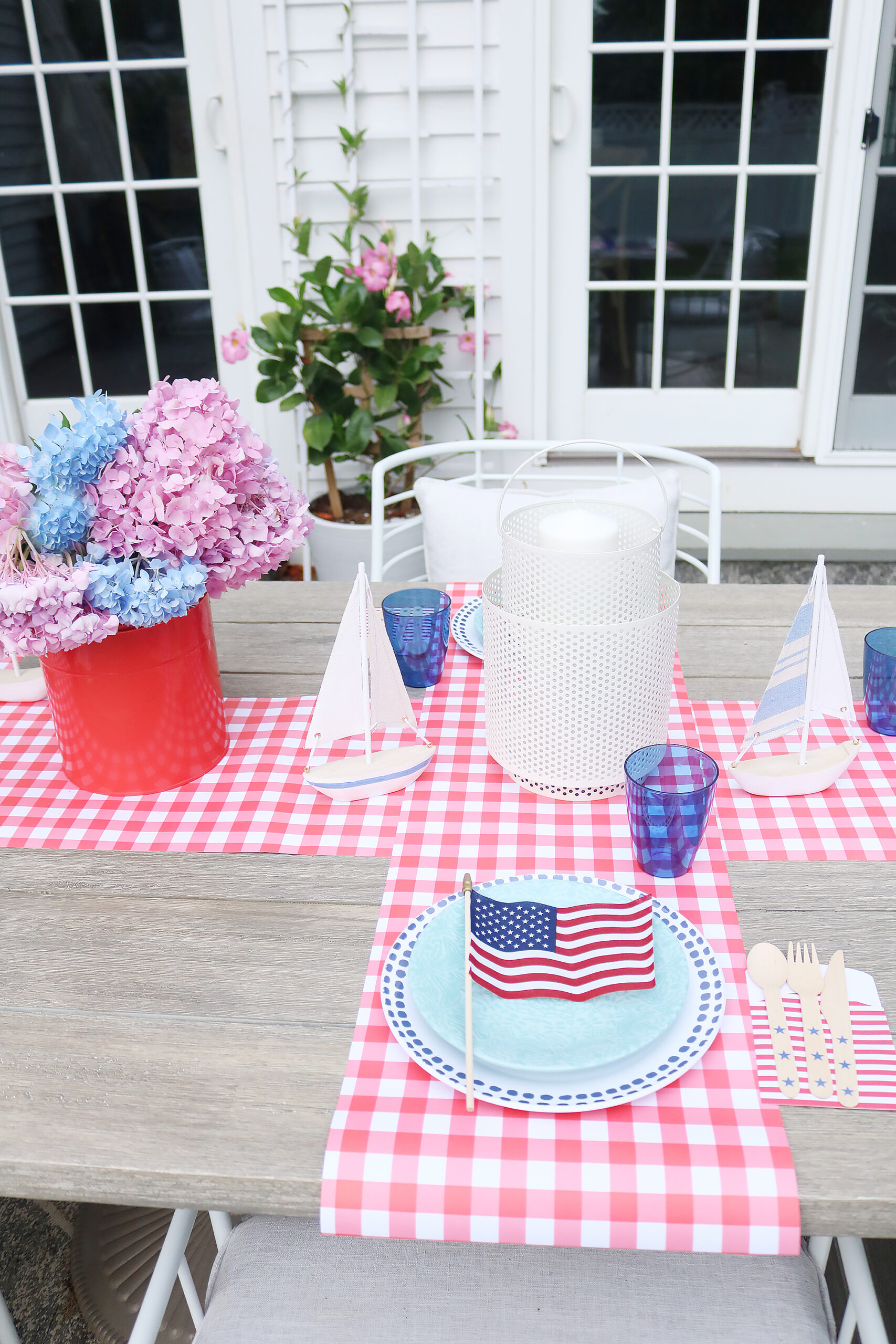 This year host a 4th of July barbecue party and sharing simple budget-friendly decorating tips, 4th of july party decorations, 4th of July outfit, red gingham dress, 4th of July entertaining tips, american flag decorations, backyard party, 4th of july tablescape  || Darling Darleen Top CT Lifestyle Blogger #4thofjuly #4thofjulyoutfit