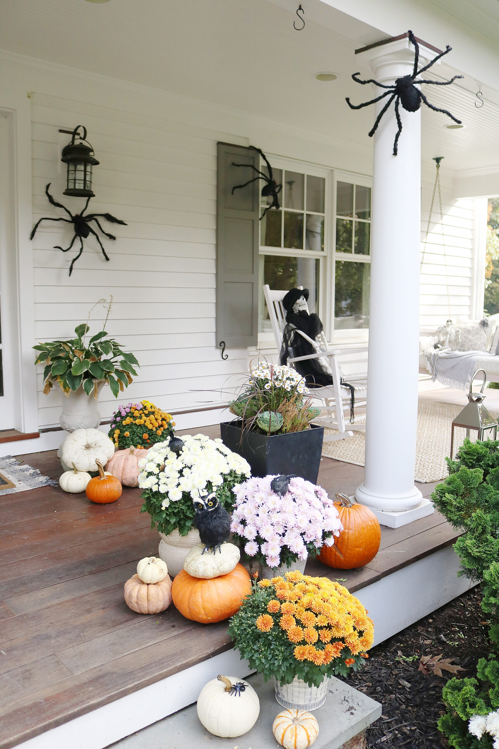 Our not-so-spooky front porch Halloween decorations with spiders and skeletons!  || Darling Darleen Top CT Lifestyle Blogger #halloweendecorations