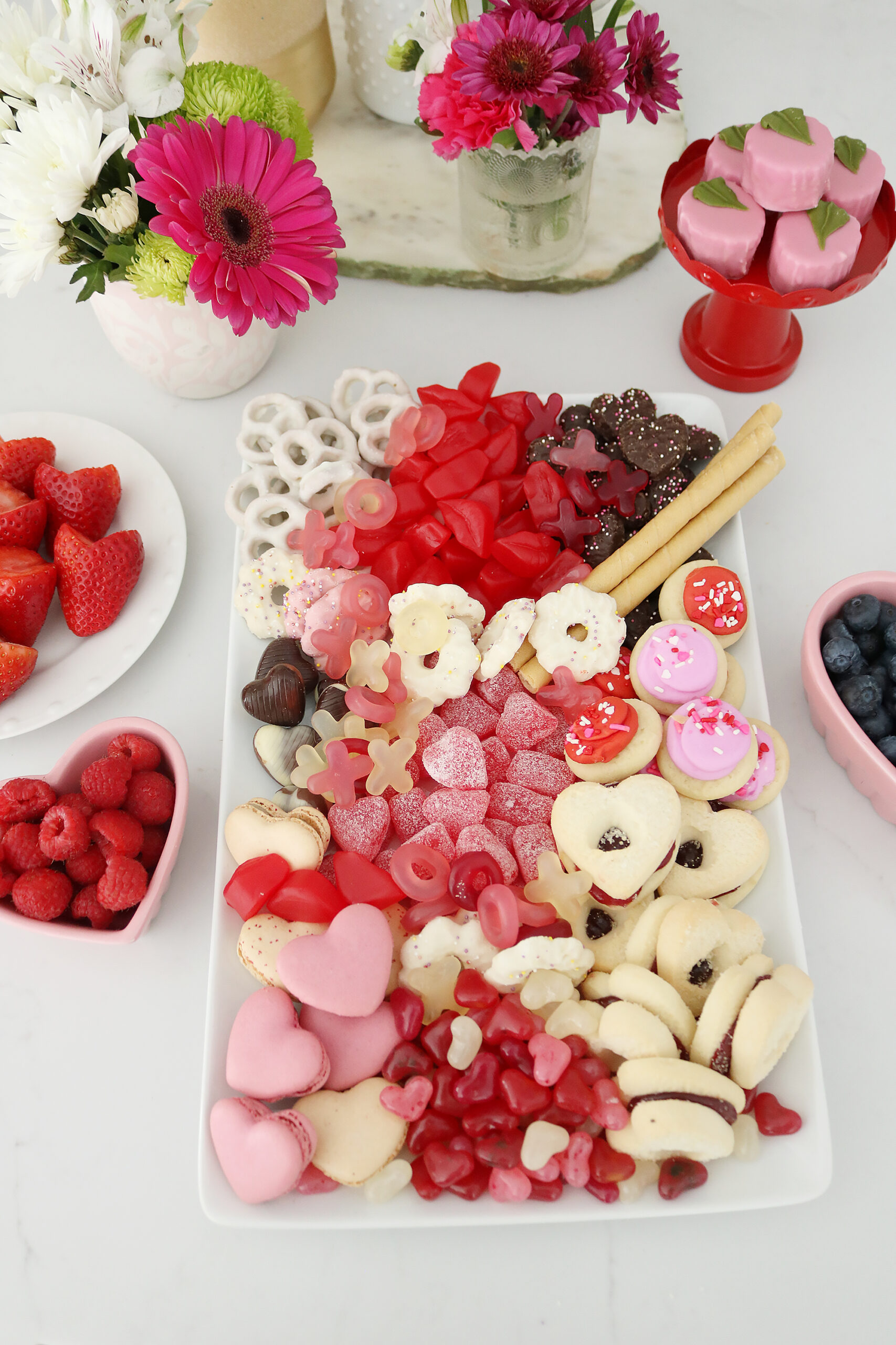 Bring Valentine's Day Home this year!  Put together a Valentine's charcuterie board with heart shaped chocolate, cinnamon lips and macrons!  So many fun Valentine's Day ideas to share with your family    Darling Darleen Top Lifestyle Blogger #ctblogger #darlingdarleen #valentinesday