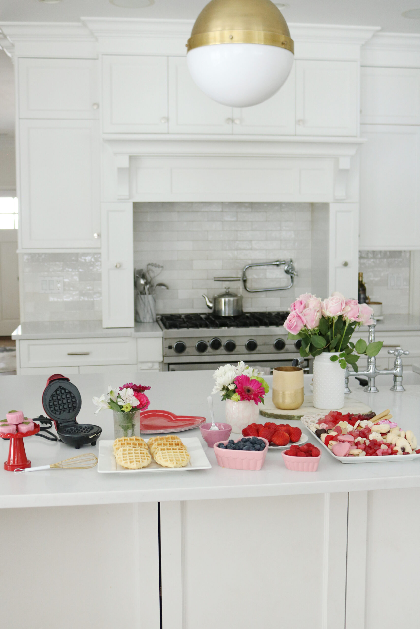 Bring Valentine's Day Home this year!  Put together a Valentine's waffle bar and breakfast of hearts and a charcuterie board with heart shaped chocolate, cinnamon lips and macrons!  So many fun Valentine's Day ideas to share with your family    Darling Darleen Top Lifestyle Blogger #ctblogger #darlingdarleen #valentinesday