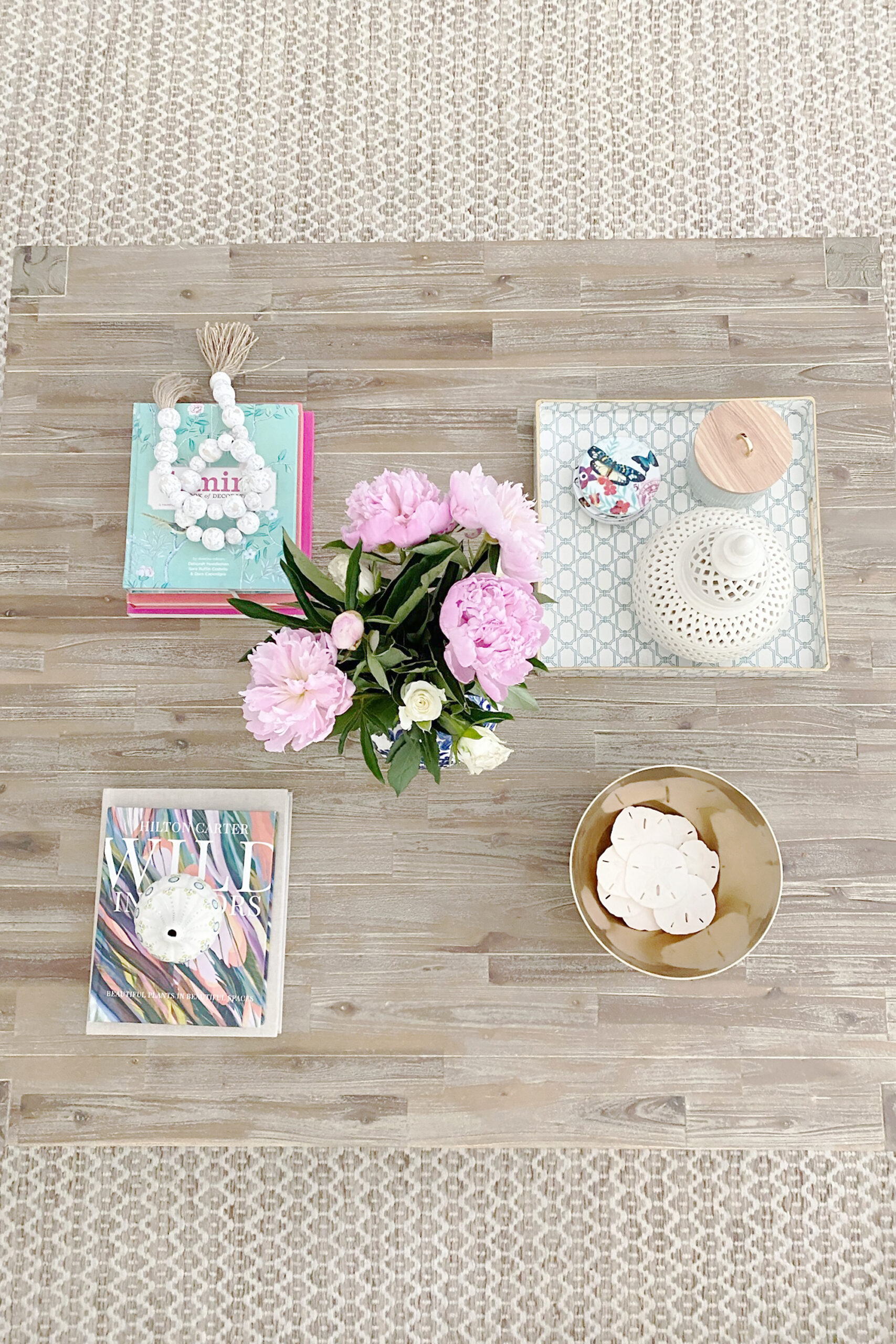 A fun and simple way for coffee table styling and the items you need to have to make it look polished and well put together. || Darling Darleen Top CT Lifestyle Blogger #coffeetablestyling #coffeetable
